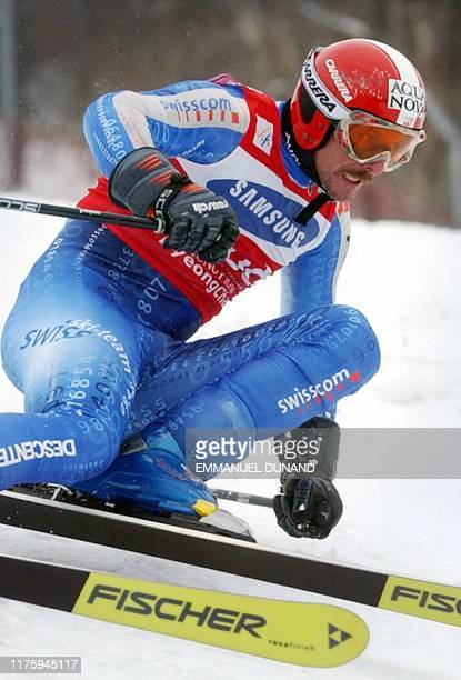 Swiss skier Michael Von Gruenigen powers his way to victory 01 March 2003 during the World Cup Men's Giant Slalom in Yongpyong some 250 kilometres...