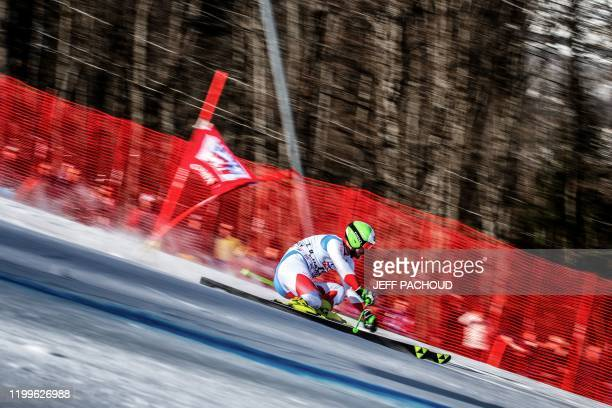 Swiss skier Thomas Tumler competes during the Audi FIS Alpine Ski World Cup Men's Parallel Giant Slalom in Chamonix France on February 9 2020