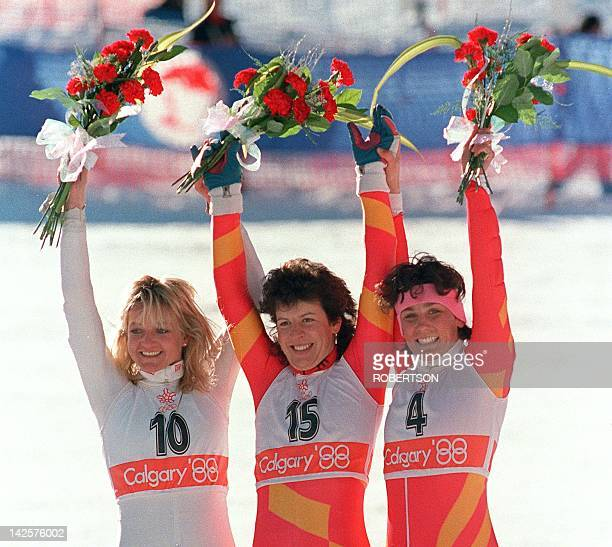 Swiss skier Vreni Schneider flanked by compatriot Maria Walliser and West German Christa KinshoferGütlein smiles as she celebrates her victory in the...