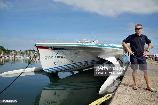 Swiss skipper Raphael Domjan poses on May 12 2011 in Noumea in front of a solar powered boat the Turanor Planetsolar The vessel which the makers say...