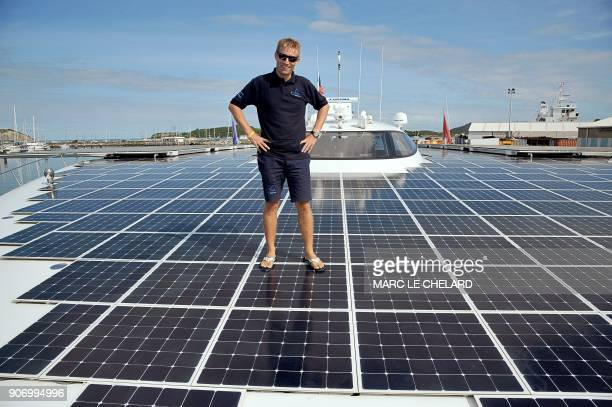Swiss skipper Raphael Domjan poses on May 12 2011 in Noumea on a solar powered boat the Turanor Planetsolar The vessel which the makers say is the...