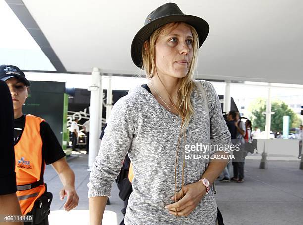 CORRECTION Swiss snowboarder AnneFlore Marxer is seen in Ezeiza international airport in Buenos Aires before her depart on March 13 2015 Four top...