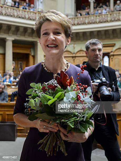 Swiss Social Democratic Party Simonetta Sommaruga holds flowers after she was elected as Swiss President by the Federal Assembly a joint session of...