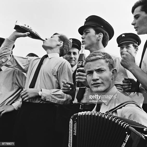 Swiss soldiers drinking CocaCola in Basel Switzerland circa 1960