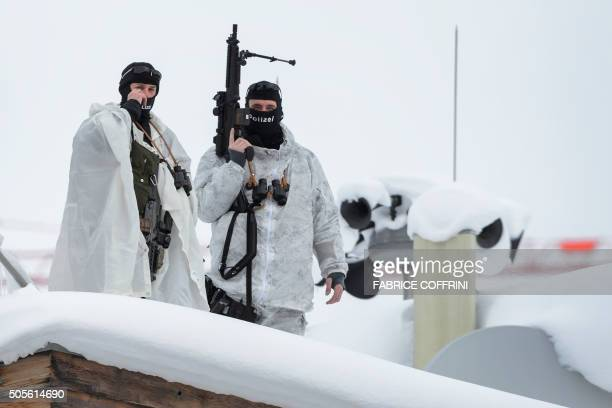 Swiss special police forces take position on the roof of a hotel at the opening of the World Economic Forum annual meeting in Davos on January 19...
