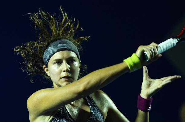 Swiss Stefanie Voegele returns the ball to Sweden´s Rebecca Peterson ...