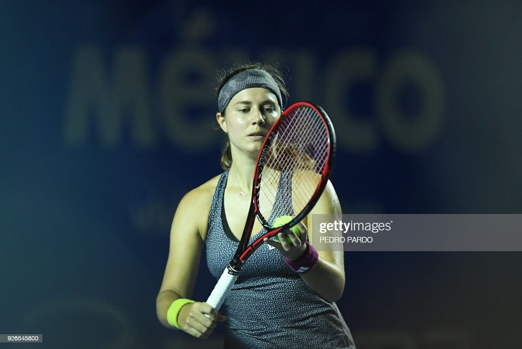 Swiss Stefanie Voegele serves to Sweden´s Rebecca Peterson (out of ...