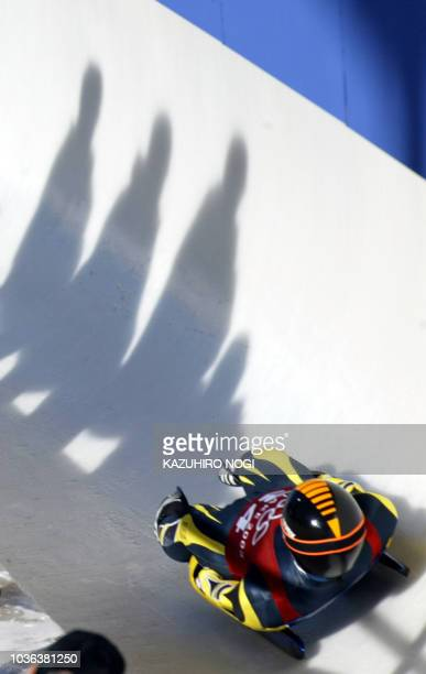 Swiss Stephan Hoehener speeds through the ice channel during a training in the men's singles luge during the Salt Lake 2002 Olympic Winter Games at...