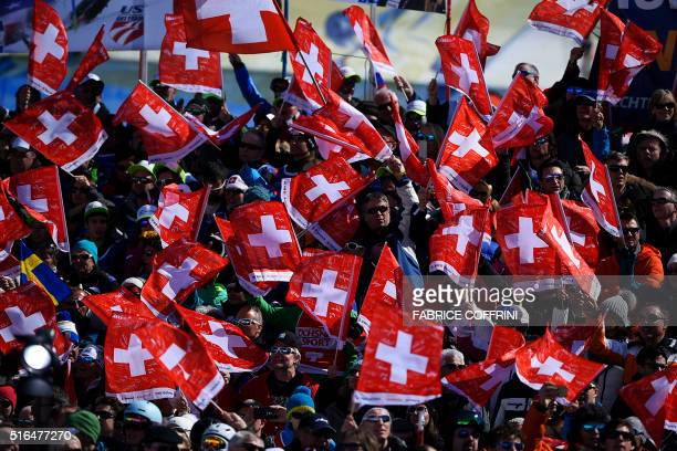 Swiss supporters attend the FIS Alpine Skiing World Cup finals in St Moritz on March 19 2016 AFP PHOTO / FABRICE COFFRINI / AFP / FABRICE COFFRINI