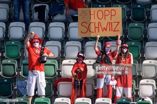 "Swiss supporters hold a placard reading ""Go Switzerland"" during a friendly football match between Switzerland and Liechtenstein at Kybunpark Stadium..."