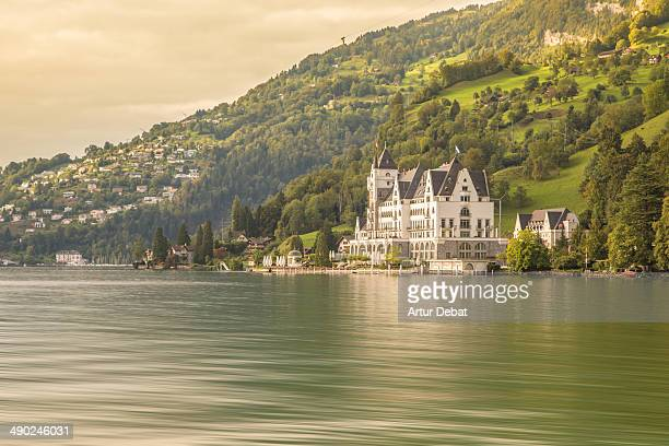 Swiss Switzerland Europe travel trip reflection water lake countryside building construction architecture vegetation mountain sky clouds sunset