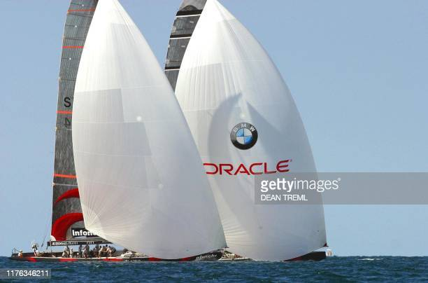 Swiss syndicate Alinghi's yacht 'Alinghi' and America's Oracle syndicate yacht 'USA-67' drag race their way to the finish line with Oracle holding a...