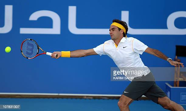 Swiss tennis champion Roger Federer returns the ball to his Swedish opponent Robin Soderling during the first semifinal in the Mubadala World Tennis...