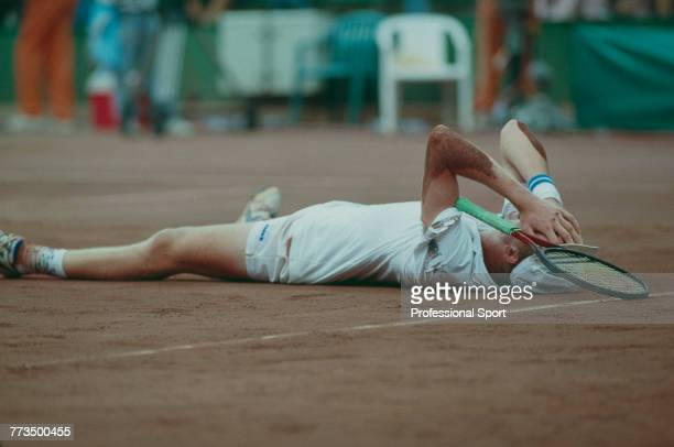 Swiss tennis player Marc Rosset of the Switzerland team pictured lying on the court at match point against Jordi Arrese of Spain before finishing in...