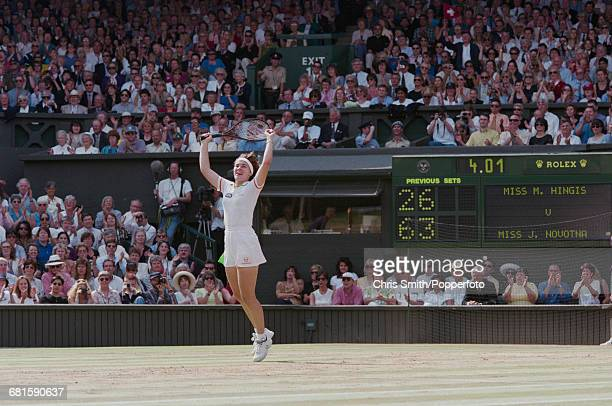 Swiss tennis player Martina Hingis throws her arms in the air in celebration after beating Czech tennis player Jana Novotna 26 63 63 in the final of...