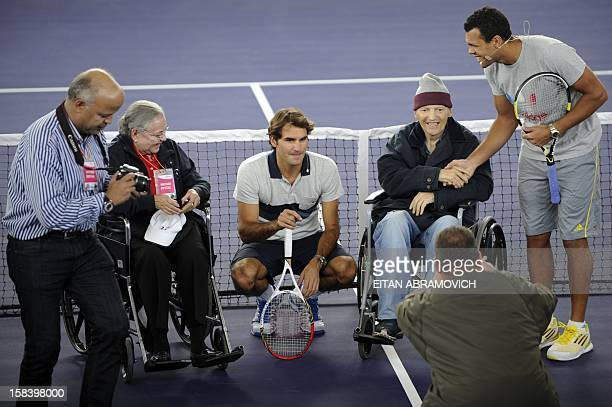 Swiss tennis player Roger Federer and French tennis player French JoWilfried Tsonga pose with supporters during a clinic in Bogota Colombia on...