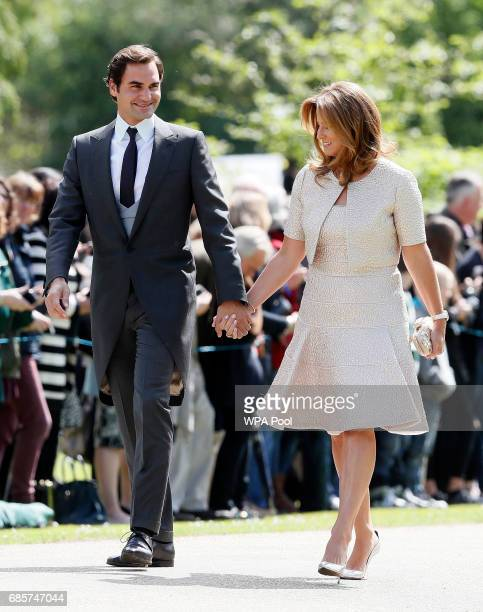 Swiss tennis player Roger Federer and his wife Mirka arrive at St Mark's Church ahead of the wedding of Pippa Middleton and James Matthews on May 20,...
