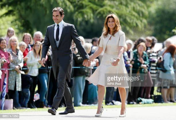 Swiss tennis player Roger Federer and his wife Mirka arrive at St Mark's Church ahead of the wedding of Pippa Middleton and James Matthews on May 20...