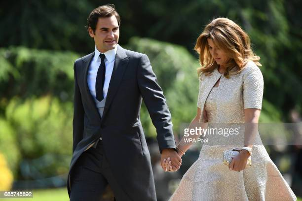 Swiss tennis player Roger Federer and his wife Mirka attend the wedding of Pippa Middleton and James Matthews at St Mark's Church on May 20 2017 in...