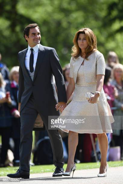 Swiss tennis player Roger Federer and his wife Mirka attend the wedding of Pippa Middleton and James Matthews at St Mark's Church on May 20, 2017 in...