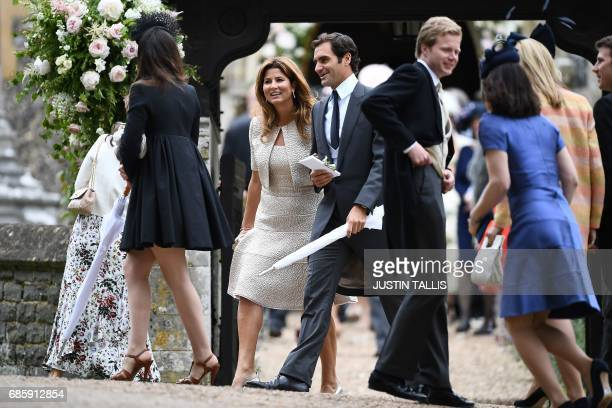 Swiss tennis player Roger Federer and his wife Mirka loeave the wedding of Pippa Middleton to James Matthews at St Mark's Church in Englefield, west...