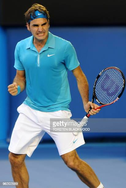 Swiss tennis player Roger Federer celebrates after victory in his quarter-final men's singles match against Russian opponent Nikolay Davydenko on the...