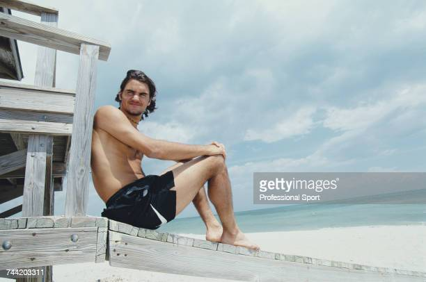 Swiss tennis player Roger Federer posed on a beach in Florida during competition to reach the second round of the Men's Singles event at the 2000...