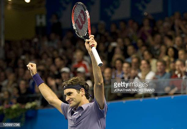 Swiss tennis player Roger Federer reacts to his win in the final of the ATP Stockholm Open tennis tournament against German's Florian Mayer in...