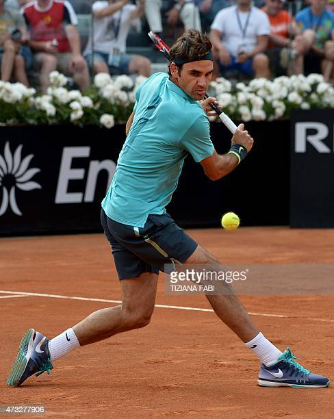 Swiss tennis player Roger Federer returns a ball to South African Kevin Anderson during the ATP Tennis Open tournament at the Foro Italico on May 14,...