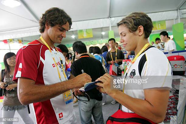 Swiss tennis player Roger Federer signs an autograph in a shop in the Olympic village prior to the start of the Olympic Games on August 5 2008 in...