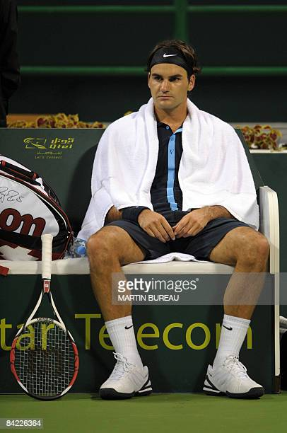 Swiss tennis player Roger Federer takes a rest between games during his semifinal match against Britain's Andy Murray in the Qatar Open 2009 in Doha...