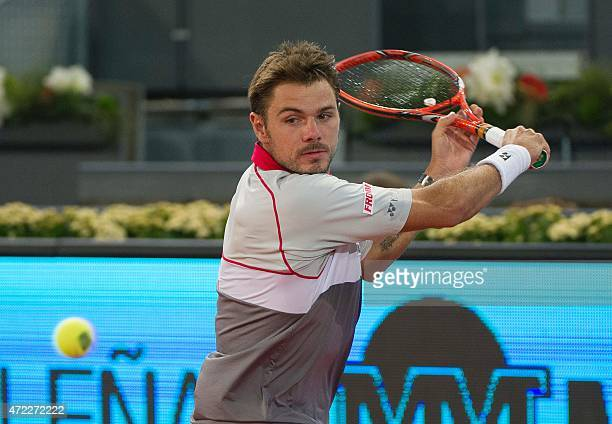 Swiss tennis player Stan Wawrinka returns a ball to Portuguese player Joao Sousa during day four of the Madrid Open tournament at the Caja Magica...