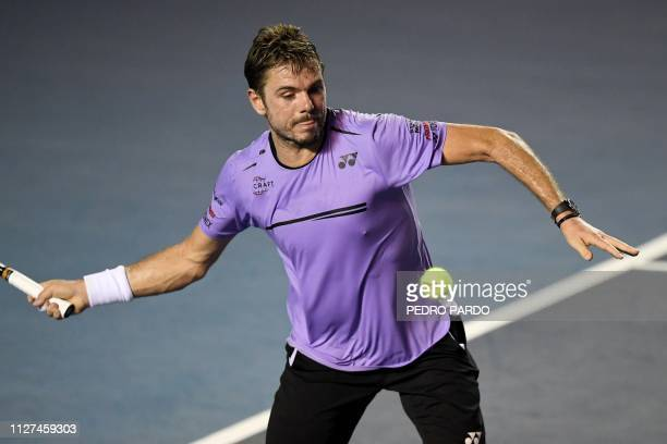 Swiss tennis player Stan Wawrinka returns the ball to US tennis player Ryan Harrison during their Mexico ATP 500 Open men's single tennis match in...