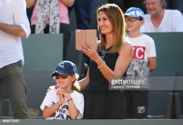 Swiss tennis player Stan Wawrinka's exwife Ilham and daughter Alexia applaud during the trophy ceremony after Wawrinka won against German tennis...