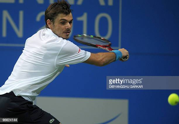 Swiss tennis player Stanislas Wawrinka plays a return shot against US opponent Michael Russell during their second round match at the ATP Chennai...