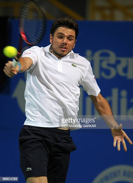 Swiss tennis player Stanislas Wawrinka plays a return shot to US opponent Michael Russell during their second round match at the ATP Chennai Open...