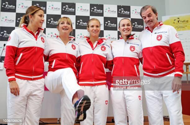 Swiss tennis players Belinda Bencic Timea Bacsinszky Viktorija Golubic Martina Hingis and Heinz Guenthardt stand together following the draw ceremony...