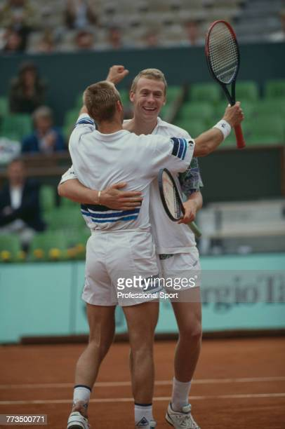 Swiss tennis players Jakob Hlasek and Marc Rosset embrace each other after beating David Adams and Andrei Olhovskiy 76 67 75 in the final of the...