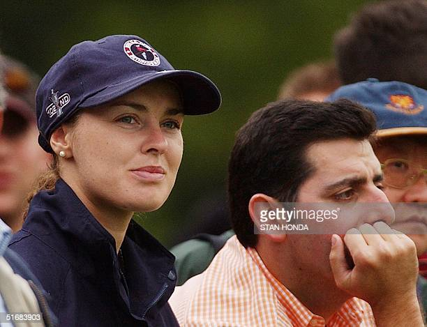 Swiss tennis star Martina Hingis watches Spanish golfer Sergio Garcia with other spectators during the third round of the 102nd US Open Championship...