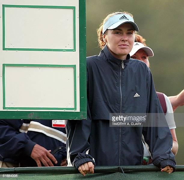Swiss tennis star Martina Hingis watches Spanish golfer Sergio Garcia on the 11th hole during the final round of the 102nd US Open Championship 16...