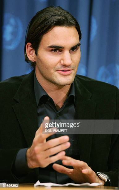 Swiss tennis star Roger Federer talks to reporters 05 November 2004 at the United Nations in New York Federer attended the UN's launching of the...