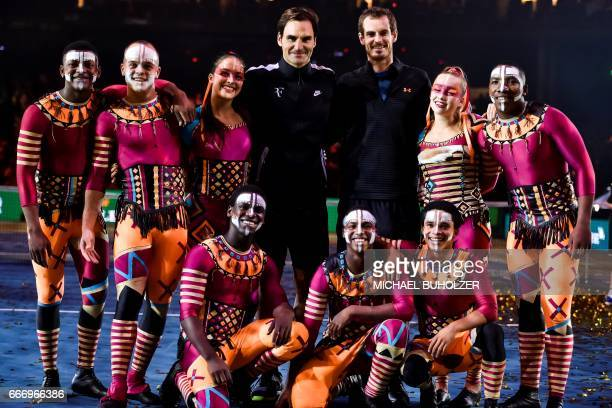 Swiss tennis superstar Roger Federer and world number one Britain's Andy Murray pose at the end of a charity match The Match for Africa 3 on April 10...