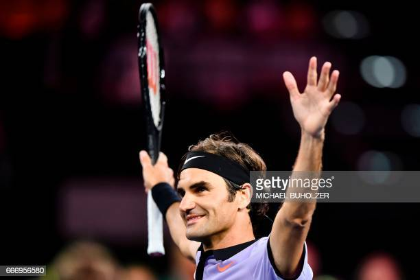 Swiss tennis superstar Roger Federer reacts after winning a charity match The Match for Africa 3 against world number one Britain's Andy Murray on...