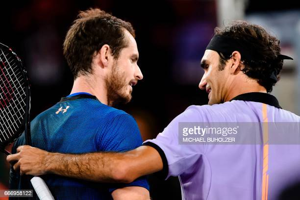 Swiss tennis superstar Roger Federer smiles to world number one Britain's Andy Murray after winning their charity match The Match for Africa 3 on...