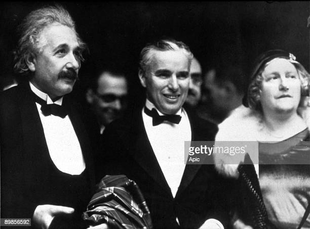 Swiss theoretical physicist of German origin Albert Einstein and his wife Elsa with English director and actor Charles Chaplin attend the premiere of...