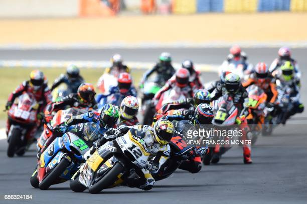 Swiss Thomas Luthi on his Kalex Garage Plus Interwetten N° 12 leads the race at the first corner ahead of Italy's rider Francesco Bagnaia on his Sky...