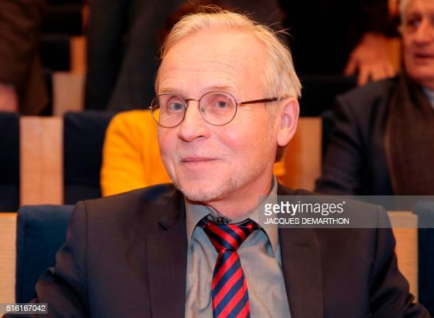 Swiss Thomas Romer professor at the College de France attends on March 17 2016 at the College de France in Paris the Congolese author Alain Mabanckou...