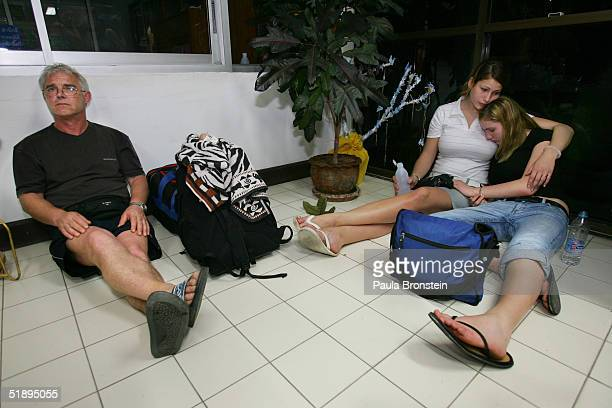 Swiss tourists cries as thy wait for news at the Phuket City Hall on December 27 2004 in Phuket Thailand Hundreds of tourists who are missing friends...