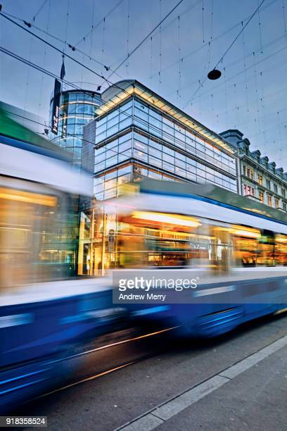 swiss tram, cable car early evening on bahnhofstrasse, zurich, switzerland - vehicle light stock photos and pictures