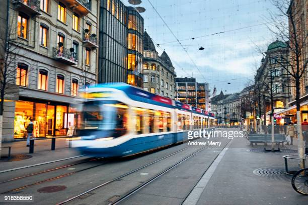 swiss tram, cable car early evening on bahnhofstrasse, zurich, switzerland - tram stockfoto's en -beelden